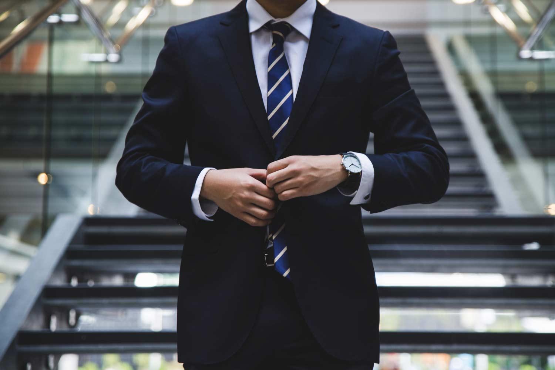 Lawyer adjusting his necktie